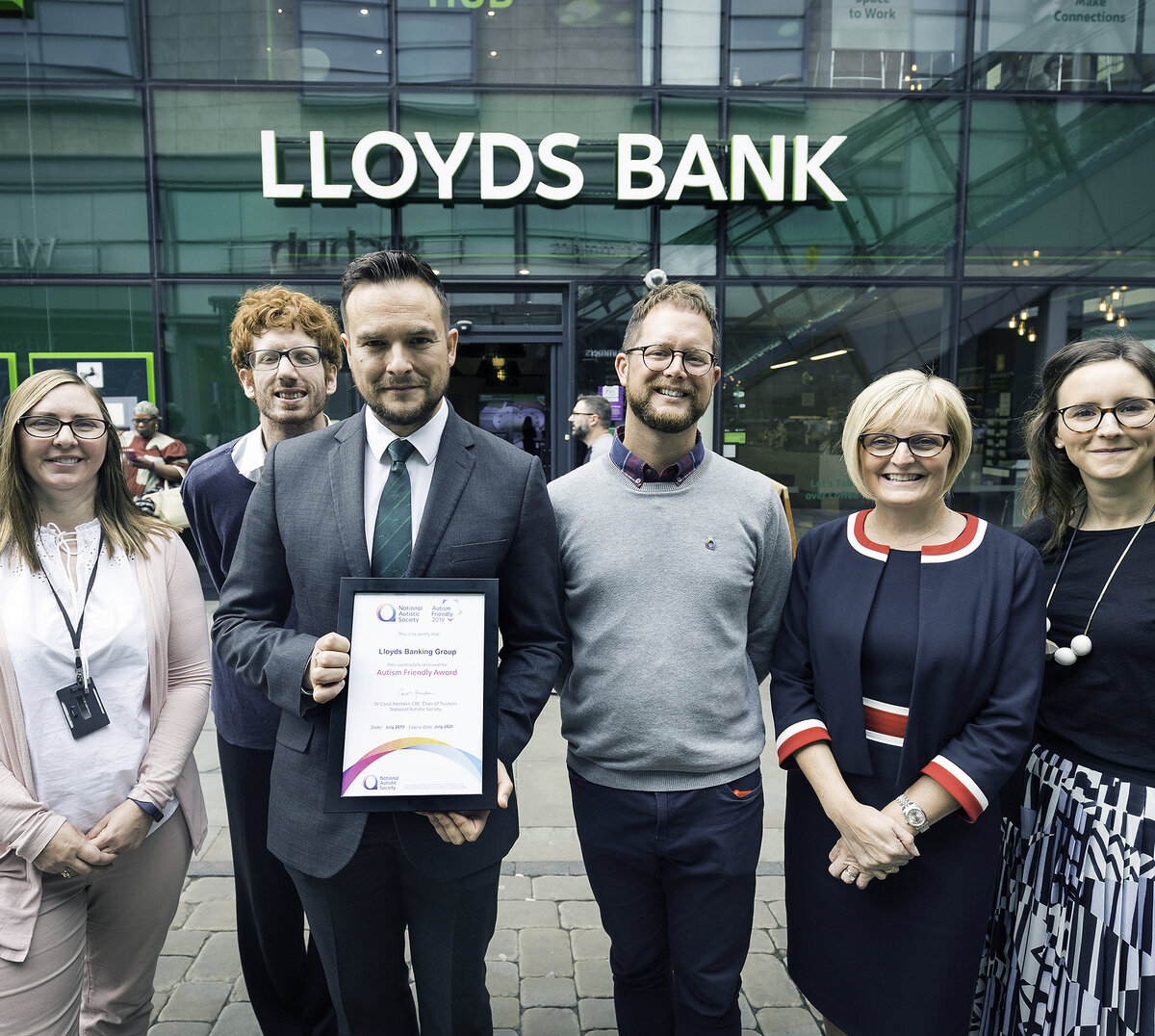 40315   National Autistic Society   18/7/19  Autism Friendly Awards presentation to Lloyds at Lloyds Bank Hub branch , Market Street , Manchester. L-R  Anne Dowle, proposition manager branch design, James Hargreaves area director of Lloyd's bank Manchester and Merseyside , Leo Capella, autism access specialist with the  National Autistic Society , Richard Forster, senior bank manager and Tom Purser , head of campaigns with the National Autistic Society , Catherine Rutter, MD of  Connect and Holly Pearce , senior manager of  group disability programme with Lloyd's banking group.
